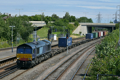 Class 66 No 66418 at Millbrook on 10 July 2014 with the 4O49 09:22 Crewe Basford Hall S.S.M. – Southampton M.C.T.