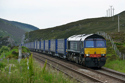 Class 66 No 66304 at Slochd Summit on 2 July 2014 with the 4H47 05:08 Mossend Up Yard – Inverness Freight Sidings
