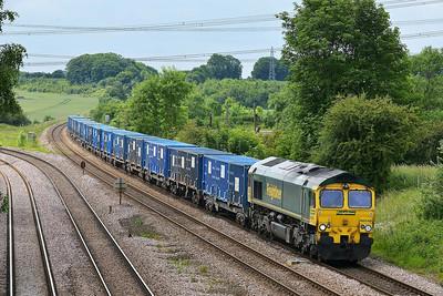 Class 66 No 66548 at Burton Salmon on 13 June 2014 with the 6E06 09:32 Bredbury R.T.S. – York Yard South