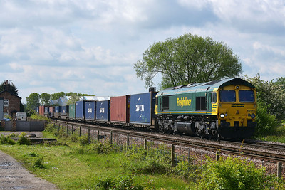 Class 66 No 66566 at Sherburn-in-Elmet on 14 May 2014 with the 4N01 10:27 Leeds F.L.T. – Wilton F.L.T.