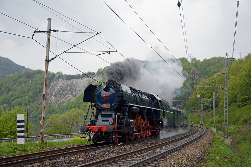At last, 498.104 in fine form. It followed a local passenger train consisting of a loco hauled formation plus a couple of four wheel railcars which were dropped at Kralovany for the branch line to Trstená