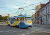 In the modern livery a single Tatra T3 crossses in front of Košice's famous pedestrian street, Hlavná ulica.