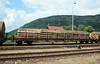 Carrying wood on flat cars is unusual, before I've seen the logs loaded in the ubiquitous box wagons.