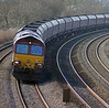 Running about 30 minutes late the 4C55 Aberthaw Power Station to East Usk Yard empty HTA coal hoppers