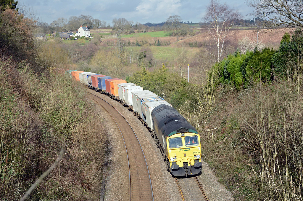 The North & West approaches Newport along the Usk Valley. In deceptively rural surroundings 66538 approaches Caerleon on the 4V64 Crewe to Wentloog. I have only seen this train once before, it was empty apart from one container. Today's was much better loaded