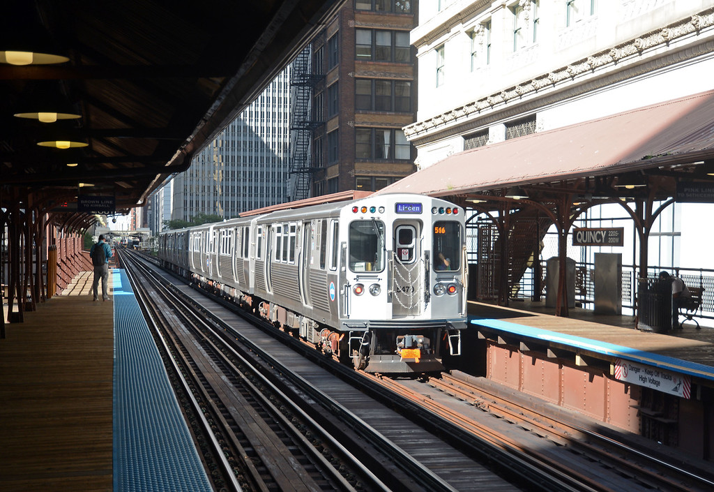 And finally, as we were waiting for a Brown Line train to take us round the Loop to our connection with the Blue Line to O'Hare at Clark & Lake, a Purple Line Express to Linden heads north away from Quincy