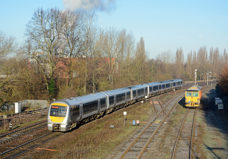 Another pair of 168 Clubmans on the 1H38, 09:10 Kidderminster to Marylebone. A piece of track plant is stabled in the yard.