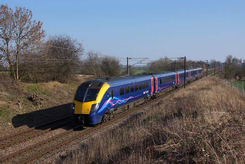 Hull Trains 180110 Soaks up the afternoon sun at Askham whilst in charge of 1H03 12:53 London Kings Cross to Hull.09/03/2014.Sony A65.