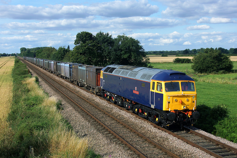 Another day,another 47...47815 'GREAT WESTERN' is seen approaching Temple Hirst in charge of 4D95 15:00 Hull Coal Terminal (Gbrf) to Doncaster Down Decoy Gbrf.Nice to see a few familiar faces and some new.21/07/2014.Sony A65.