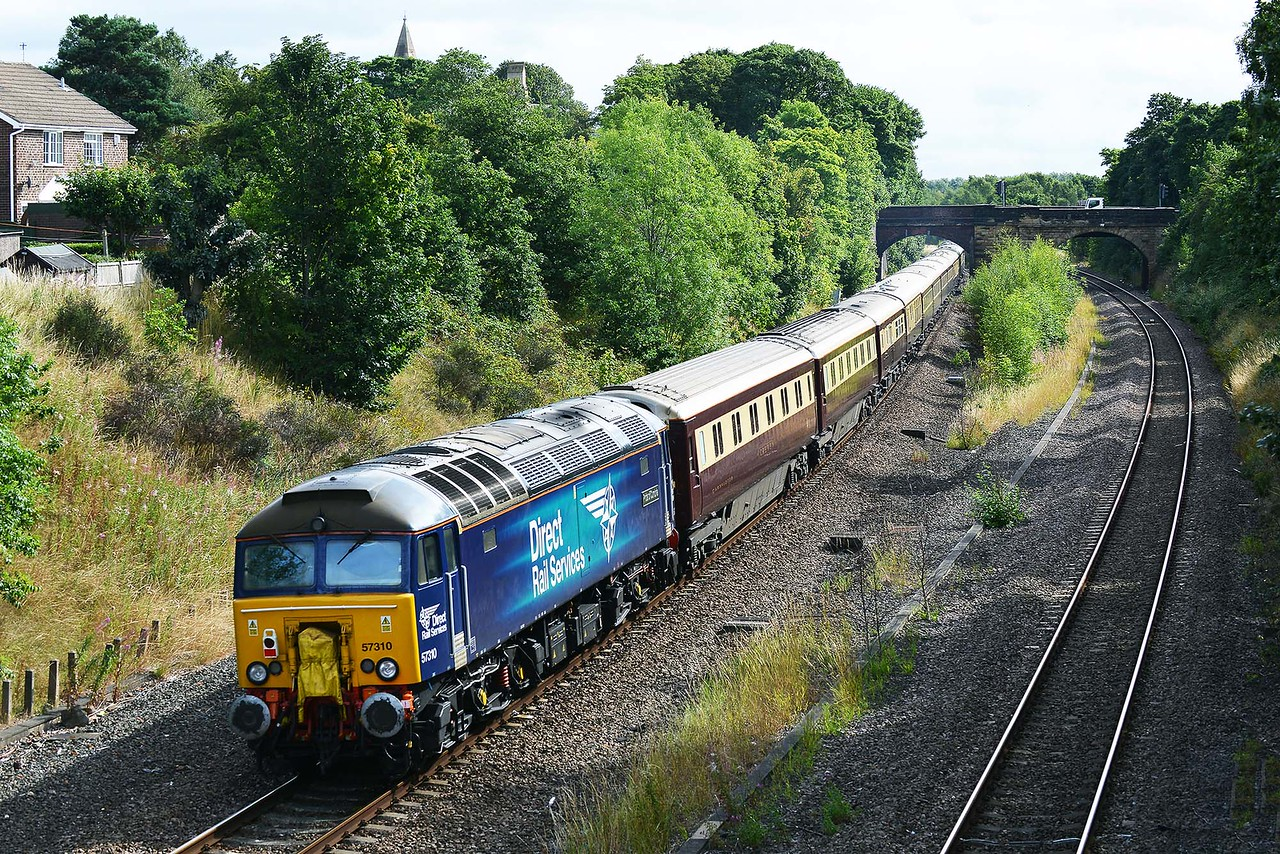 Class 57 No 57310+57301 in Horbury Cutting on 21 August 2015 with the 1Z42 07:04 Chester – Alnmouth