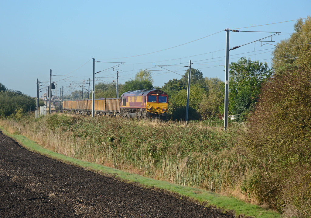 And here it is just over four minutes later approaching the Ely Road crossing in Queen Adelaide having just crossed Ely North Junction.