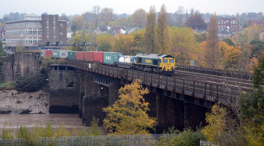 """66516 crossing the Usk on the 4O70 Wentloog to Southampton, running about 15 minutes late. It was well filled, mainly with 9'6"""" boxes on lo liners and pocket wagons."""
