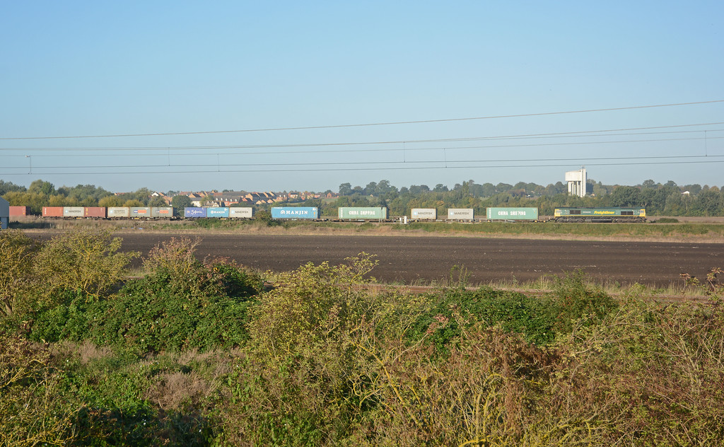 66532 speeds away from Ely North Junction on the Peterborough line on the 4E22 Felixstowe to Leeds, another well loaded train.