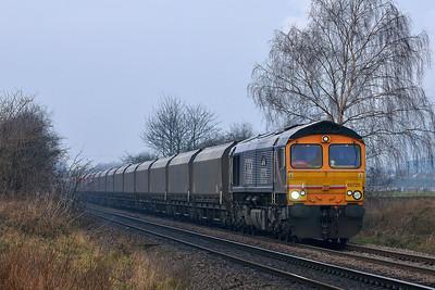Class 66 No 66725 at Blackburn Lane, Knottingley on 20 January 2015 with the 6H12 06:25 Tyne Coal Terminal – Drax Power Station