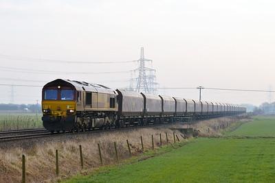 Class 66 No 66077 at Blackburn Lane, Knottingley on 20 January 2015 with the 4R15 09:55 Drax Power Station - Humber International Terminal