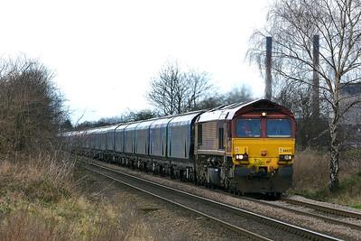 Class 66 No 66025 at Blackburn Lane, Knottingley on 6 January 2015 with the 6H84  08:38 Hull Biomass Lp - Drax Power Station