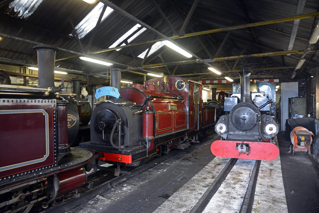 Linda sat on the adjacent road, the atmosphere thick with the smell of warm steam engines.