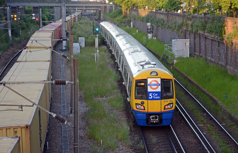One of LOROL's new-ish five car 378 sets on an East London Line service heads towards Dalston Junction, whilst the 4M02's boxes continue to roll by