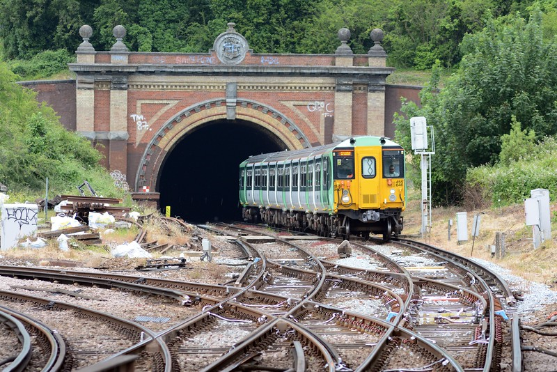 Engineering work beyond Norwood Junction meant that the London Bridge to Sutton via Crystal Palace service was terminating at Crystal Palace. A 455 bound for CP emerges from Knights Hill Tunnel. The ornate tunnel mouth contains the coat of arms of Alleyn's school, the local landlord.