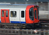 A Metropolitan Line S8 set on a Baker Street train, racing past Neasden Depot