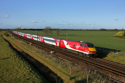 Sporting her new VTEC livery 82214 speeds south at Colton in charge of 1E23 16:30 Edinburgh to London Kings Cross in glorious light.30/04/2015.Sony A65.