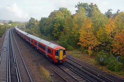 A Victoria bound Gatwick Express from Brighton on the Quarry Line passing some suitably autumnal foliage.