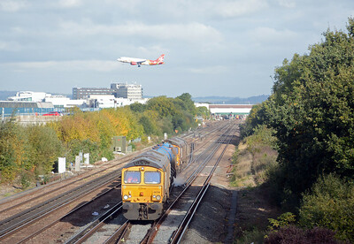 An Air Malta Airbus lands as the train crosses from slow to fast.