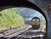 66142 was making plenty of noise and belching exhaust as it approached Balcombe station up the gradient. The following Bedford service was coasting on 66142's tail as the freight cleared Balcombe Tunnel Junction and took the slow line.