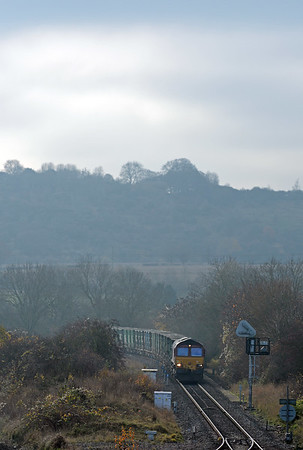 The 6M22 Cricklewood to Calvert binliner approaching Princes Risborough, with the Chiltern escarpment in the background.