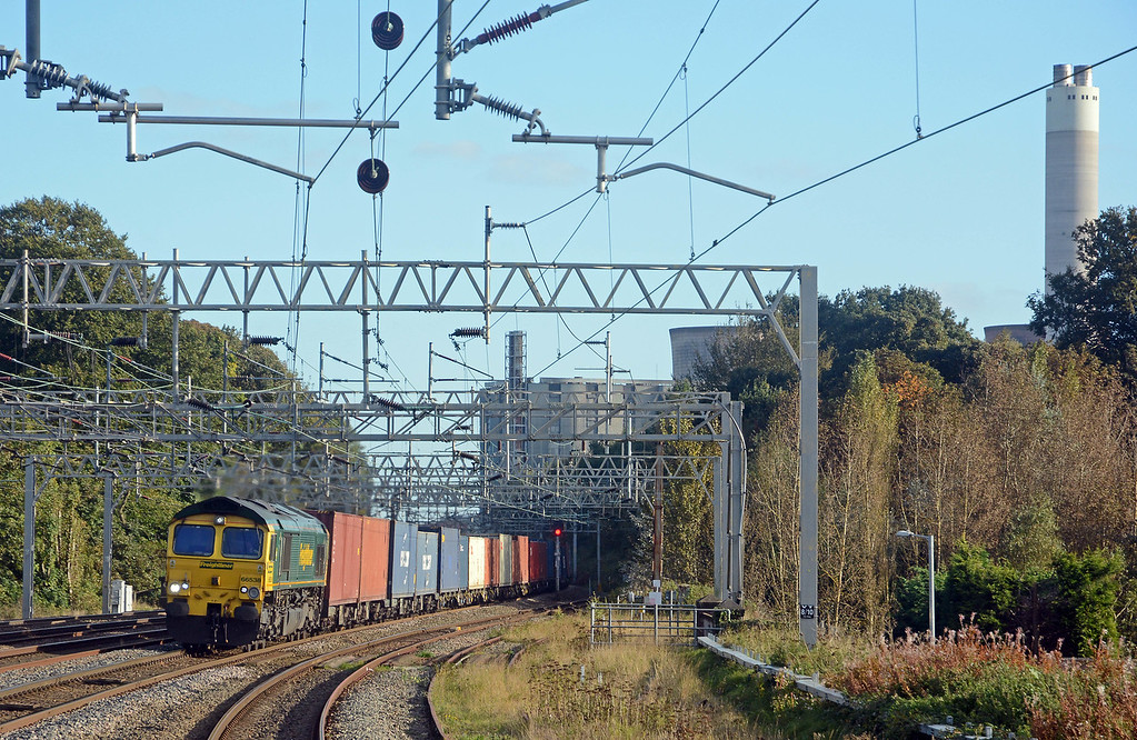66538 passing the dormant bulk of Rugeley's decommissioned generating station on the 4M61 Southampton to Trafford Park.
