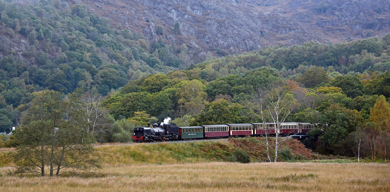 The Caernarfon to Porthmadog was in charge of NGG16 no.87 (the Belgian). It's descending from Nantmor onto the flood plain of the Afon Glaslyn.