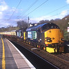 """37602 and 37610 T.S. (Ted) Cassaday storm through Oxenholme with the Carlisle - Eastleigh return leg of Pathfinder Tours """"Spring West Highlander"""" 4 day tour with one of Carlisle's top men at the helm, 25/4/2016."""