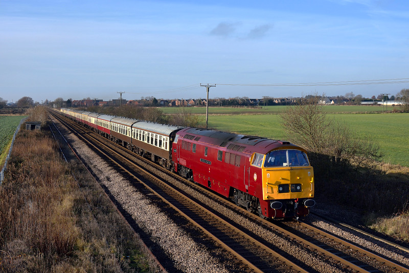 Looking and sounding glorious D1015 'WESTERN CHAMPION' Races towards Ferriby in charge of the late running 1Z17 Swindon-Scarborough railtour in the capable hands of Driver Joe Wray.17/12/2016.Taken using a pole.