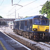 Caledonian Sleeper liveried 92038 passes Oxenholme running light from Crewe to Carlisle, 23/5/2016.
