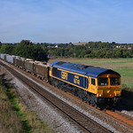 66748 'West Burton 50' eases towards Hare Park in charge of 6D35.03/10/2016.Taken with a pole.