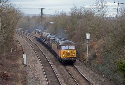 56302 and 56094 are the current motive power on the 3S91 Gloucester based RHTT. They're approaching Hereford, having just left the Ledbury line at Shelwick Junction.