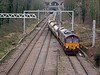Running a few minutes late 66092 on the 6L35 Grain to Ferme Park climbing the spur to the ECML