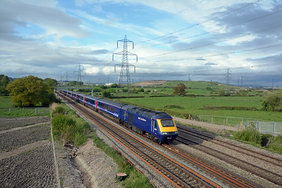 The 16:15 Paddington to Swansea HST gathering speed after crossing from the down relief to the down main.