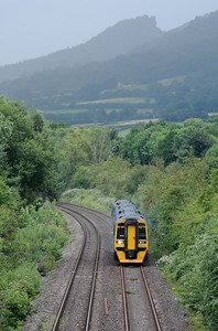 You can just see the tail light of the final BYA through the greenery as the 10:20 Holyhead to Cardiff appeared. Behind a storm is raging over the Skirrid - the Holy Mountain - and Llanvihangel Crucorney.