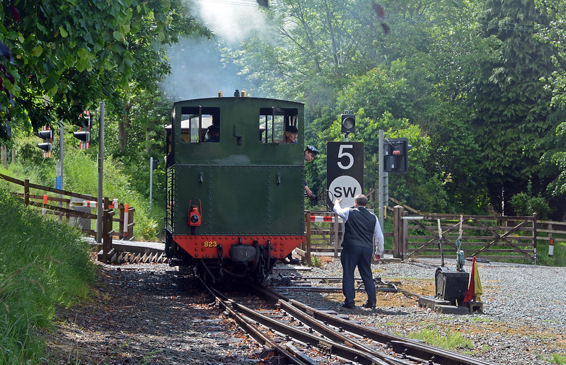 In the opposite direction the fireman on Countess surrenders the train staff for the section from Llanfair.