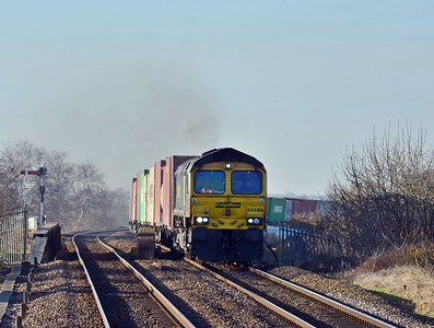 66588 crossing the Whittlesey Dike navigation on the 4L93 Lawley Street to Felixstowe