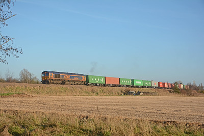 66764 speeding round the curve west of Whittlesea on the 4M29 Felixstowe to Birch Coppice.