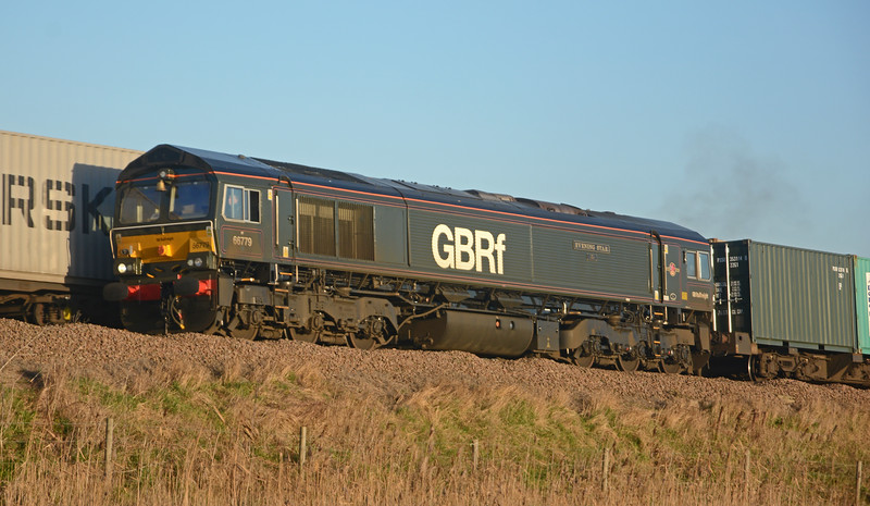 66779 wears BR Brunswick Green and carries a commemorative bell.