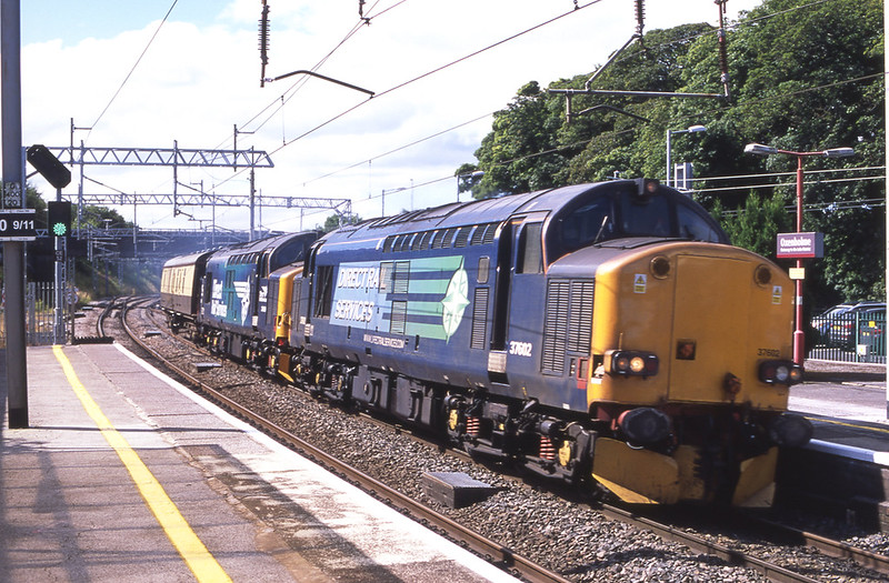 37602 and 37609 thunder through Oxenholme with a generator van in tow en-route from Burton-Kingmoor, 9/8/2017.