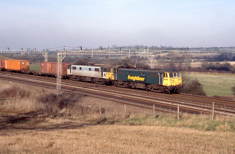 A scene that has not changed too much in the intervening years, double headed 86s still plug up and down the WCML in Freightliner service. Sadly palisade fencing has now disfigured the lineside.