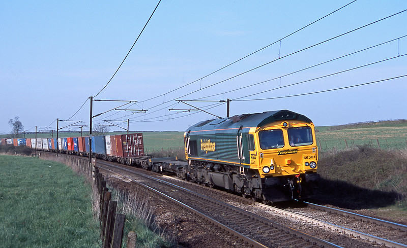 From the adjacent field 66581 on long time favourite 4L85 Leeds to Felixstowe.