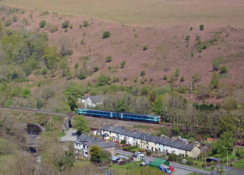 Network Rail has removed all the trees which were growing on the embankment through Commins Coch, opening out the view. Commins Coch is a small settlement on the A470 between Talerddig and Cemmaes Road
