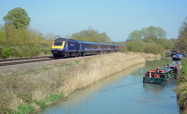 Just over 30 minutes later the 12:34 Paddington to Taunton semi-fast passing a canal cruiser mooring in preparation for locking down.