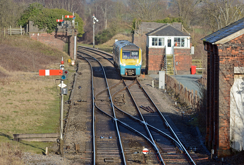 In the opposite direction the 10:40 Holyhead to Llanelli passes the signal box. Until 1961 Woofferton was the junction with the Wyre Forest line to Tenbury Wells and Bewdley.