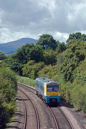 In the opposite direction the bulk of the Black Mountains looms up as 175001 heads north on the 09:10 Milford Haven to Manchester Piccadilly (arr 15:08), 288 miles in a shade under six hours with 23 intermediate stops.
